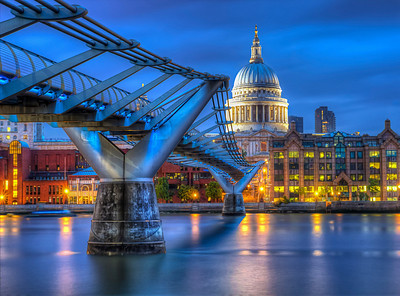 "The Millennium Bridge, officially known as the London Millennium Footbridge, is a steel suspension bridge for pedestrians crossing the River Thames in London, linking Bankside with the City of London. It is sited between Southwark Bridge and Blackfriars Railway Bridge. The Millennium Bridge is owned and maintained by Bridge House Estates, a charitable trust overseen by the City of London Corporation. Construction of the bridge began in 1998, with the opening in June 2000.  Londoners nicknamed the bridge the ""Wobbly Bridge"" after participants in a charity walk on behalf of Save the Children to open the bridge felt an unexpected and, for some, uncomfortable swaying motion on the first two days after the bridge opened. The bridge was closed later that day, and after two days of limited access the bridge was closed for almost two years while modifications were made to eliminate the wobble entirely. It reopened in 2002.  The southern end of the bridge is near the Globe theatre, the Bankside Gallery and Tate Modern, the north end next to the City of London School below St Paul's Cathedral. The bridge alignment is such that a clear view of St Paul's south façade is presented from across the river, framed by the bridge supports.  Equipment=Canon T3I Rebel Lens Used=Tamron AF 17-50mm F/2.8 XR Di-II LD SP Aspherical (IF) Zoom Lens Exposures=7 Location=London England  Workflow=PhotoMatix 4.2 Adobe PhotoShop Cs6(Lightning Adjustments=-2) Adobe PhotoShop Cs6  Adobe Light room 5 Software, Nik Color Efex=Tonal Contrast(Colors Only), Detail Extractor, and Glamor Glow  Topaz Adjust 5=Photo Pop  OnOne Perfect Photo Suite 7=Magic Ocean"