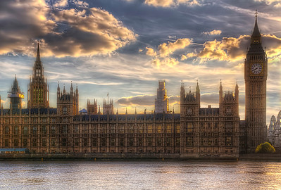 The Palace of Westminster is the meeting place of the House of Commons and the House of Lords, the two houses of the Parliament of the United Kingdom. Commonly known as the Houses of Parliament after its tenants, the Palace lies on the Middlesex bank of the River Thames in the City of Westminster, in central London. Its name, which derives from the neighbouring Westminster Abbey, may refer to either of two structures: the Old Palace, a medieval building complex that was destroyed by fire in 1834, and its replacement New Palace that stands today. For ceremonial purposes, the palace retains its original style and status as a royal residence.  The first royal palace was built on the site in the eleventh century, and Westminster was the primary London residence of the Kings of England until a fire destroyed much of the complex in 1512. After that, it served as the home of Parliament, which had been meeting there since the thirteenth century, and the seat of the Royal Courts of Justice, based in and around Westminster Hall. In 1834, an even greater fire ravaged the heavily rebuilt Houses of Parliament, and the only structures of significance to survive were Westminster Hall, the Cloisters of St Stephen's, the Chapel of St Mary Undercroft and the Jewel Tower.  Equipment=Canon T3I Rebel Lens Used=Tamron AF 17-50mm F/2.8 XR Di-II LD SP Aspherical (IF) Zoom Lens Exposures=7 Location=London England  Workflow= PhotoMatix 4.2 Adobe PhotoShop Cs6(Lightning Adjustments=-2) Adobe Light room 5 Software, Nik Color Efex=Glamor Glow, Tonal Contrast(Colors Only),Sunlight, and Brilliance/Warmth Topaz Adjust 5=Photo Pop  Topaz Details 3  Nik Sharpener Pro 3.0