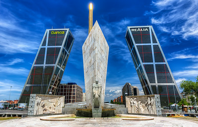 The Gate of Europe towers (Spanish: Puerta de Europa), also known as KIO Towers (Torres KIO), are twin office buildings in Madrid, Spain. The towers have a height of 114 m (374 ft) and have 26 floors. They were constructed from 1989 to 1996. The Puerta de Europa is the second tallest twin towers in Spain after the Torres de Santa Cruz in Santa Cruz de Tenerife.  Equipment=Canon EOS 6D (Canon 6D) Lens Used=Tokina 17-35mm F/4 AT-X Pro FX Lens Exposures=7 Location=Madrid Spain  Workflow= PhotoMatix 5 Adobe PhotoShop Cs6 Adobe Light room 5  Software, Nik Color Efex=Pro Contrast  Nik Viveza