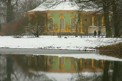 "Reflection of the Dragon's house on the water The dragon's house (Drachenhaus) was built in a ""chinese"" roccoco style at the Sanssouci park of Potsdam, Germany."