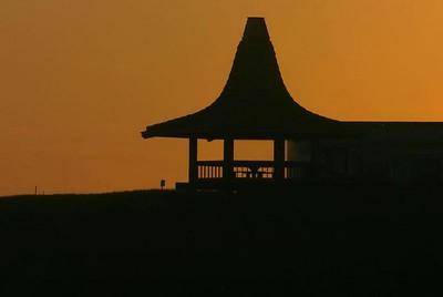 Sunset on the Monterey Bay, silhouetting a private patio, Santa Cruz, California.
