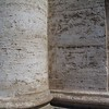 Travertine stone used here in the columns of Chiesa Nuova and many Roman structures. Cheaper and easier to work with than true marble but very durable.