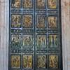Intricate bronze sculptures grace each inlay of St. Peter's Basilica's northeast entrance door.