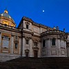 Santa Maria Maggiore at night, lit by the glow of Rome's evening streets and a hint of twilight.