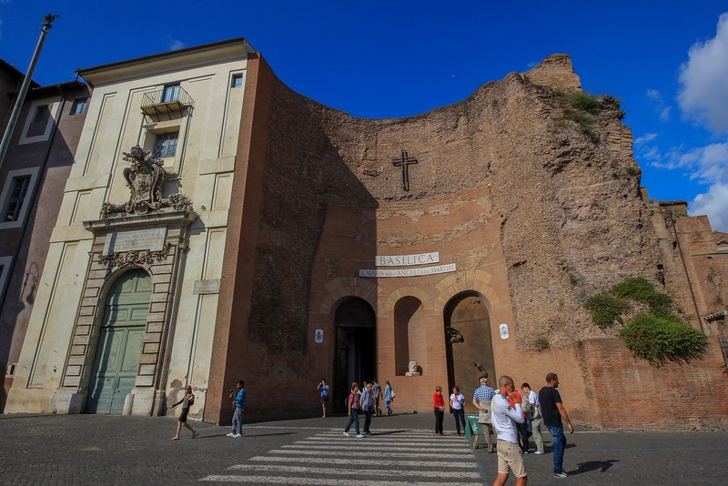 The main entry to Basilica Santa Maria degli Angeli uses Roman Bath ruins from the early 4th century. Michaelangelo designed the church but did not live to see it finished.