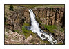 A view of Clear Creek Falls in Colorado, just off State Hwy 149 south of Lake City.  If you look closely, you can see a bit of a rainbow in the falls.