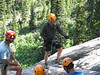 Our second guide, Dave, check's out Rob's technique as he practices the rappel.