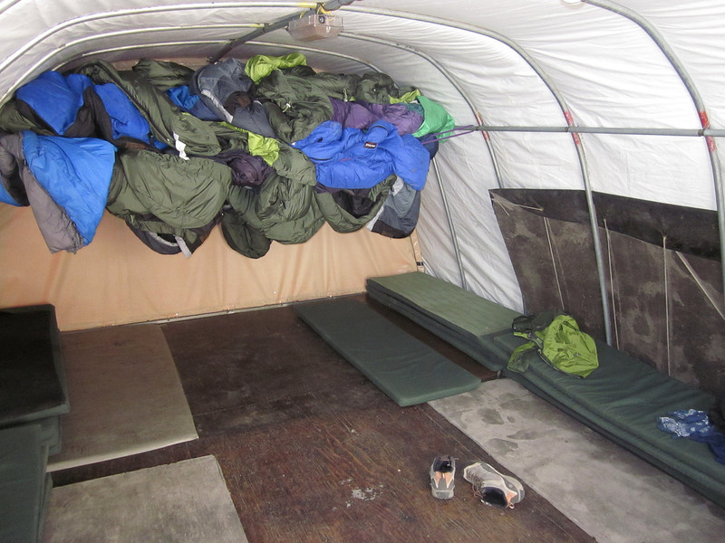 The inside of the climbers hut was luxurious -- just enough room for sleeping bags and pads for 15 -- and a stove for heating hot water.