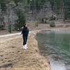 Sarah skipping stones on frozen pond
