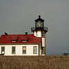 And then, for just a moment, the sun comes out and lights up the lighthouse.