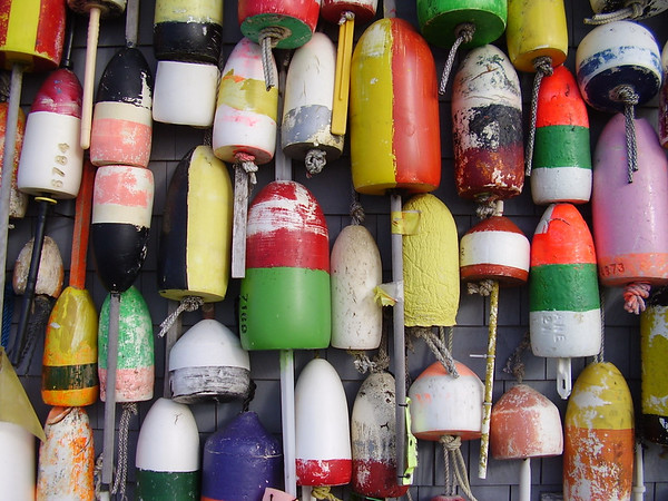Colorful buoys on a fishing shack in Provincetown, Cape Cod, Massachusetts.