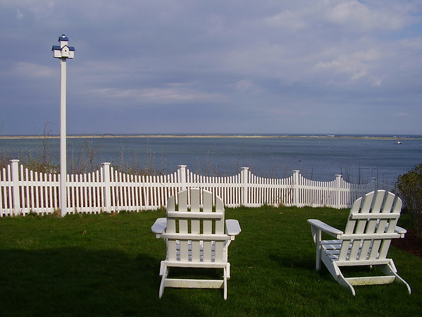 Lawn chairs overlooking Chatham Bar.  Chatham, Cape Cod, Massachusetts.