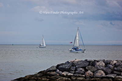 Two sailboats ply the waters of the Cheasapeake Bay off Fort Monroe