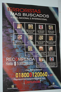 If you enlarge this photo of wanted FARC members, you can see two of the recently killed ones crossed off with pen.