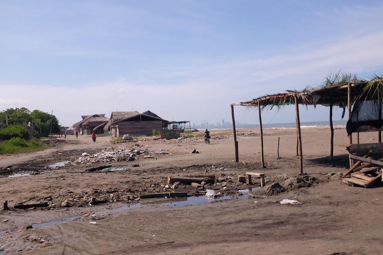 Dozens of seafood restaurants (grass shacks, or close) line the long beach.