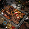 Our parrillada dinner (well, the first one): chorizo, steak, morcilla (blood sausage), pork chops, some chicken, a few other unidentifiable meats.