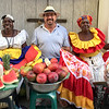 Joe with the colorfully dressed fruit sellers in Cartagena