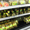 Seeking next day's breakfast at the supermarket, where a whole section is dedicated to tamales.