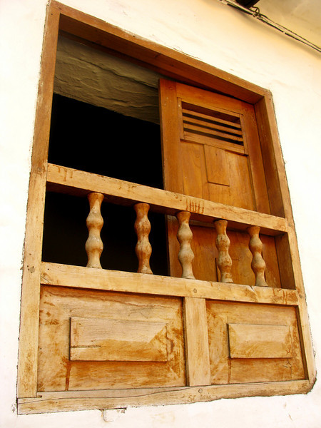 Back on the mean streets of Barichara: Most of the windows had cute wooden bars like these. Best part was when someone's head poked over the top.