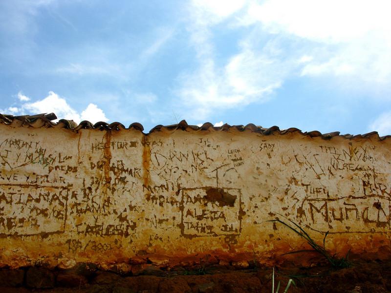 Some graffiti scrawl at the top.