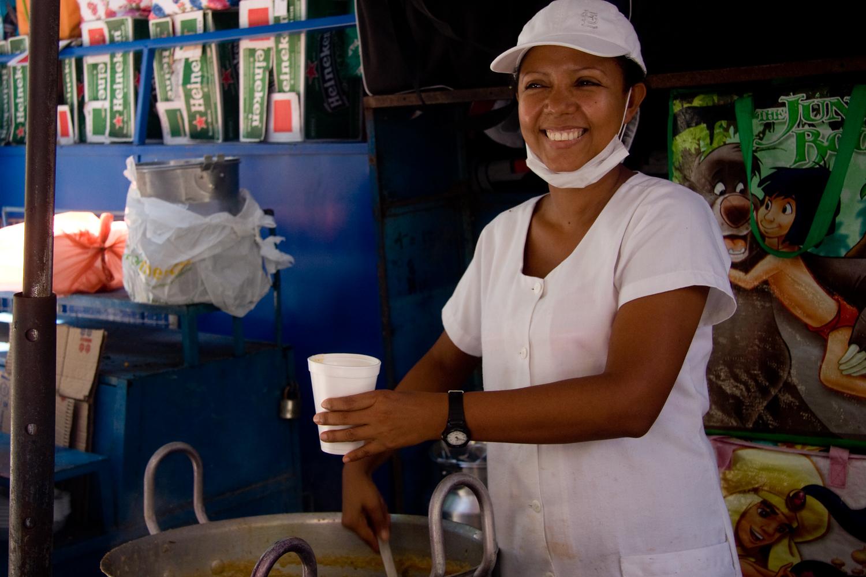 Marta sells fish soup at a market in Santa Marta Colombia