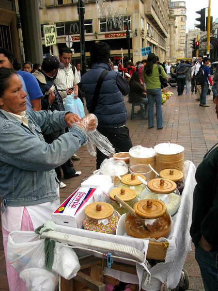 "Vendor selling obleas in the city: a thin wafer ""sandwich"" with arequipe, the country's delicious take on caramel, spread in between. This woman had a bunch of other toppings on hand, too. You can find these on the streets of Jackson Heights as well."