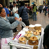"""Vendor selling obleas in the city: a thin wafer """"sandwich"""" with arequipe, the country's delicious take on caramel, spread in between. This woman had a bunch of other toppings on hand, too. You can find these on the streets of Jackson Heights as well."""