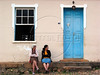"""Women sit in front of a  house in Tiradentes, in the Brazilian state of Minas Gerais. The town which sits in a green valley, is named after the man known as """"Tiradentes"""" (tooth puller), Joaquim Jose da Silva Xavier, martyred heroe of the Minas revolution.(Australfoto/Douglas Engle)"""