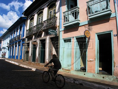 A cyclist rides past historic buildings in Mariana, in the state of Minas Gerais.(Australfoto/Douglas Engle)