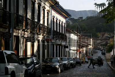 A street scene of Mariana, the oldest city in Minas Gerais state, founded in 1703. The soapstone relief on the doorway is by Aleijadinho. Development of the region was fueled by the discovery of gold in the 18th century, which is the reason for the multitude of colonial cities. Today the state still depends on mining, but now it is iron-ore and other industrial minerals. (Australfoto/Douglas Engle)