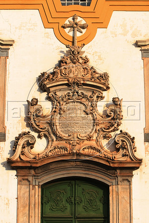 Detail of the doorway of  the Sao Francisco Church in Mariana, the oldest city in Minas Gerais state, founded in 1703. The soapstone relief on the doorway is by Aleijadinho. Development of the region was fueled by the discovery of gold in the 18th century, which is the reason for the multitude of colonial cities. Today the state still depends on mining, but now it is iron-ore and other industrial minerals. (Australfoto/Douglas Engle)