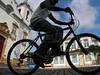 A man rides a bicycle past the Nossa Senhora de Rosario church in Sao Joao del Rei in the Brazilian state of Minas Gerais.(Australfoto/Douglas Engle)