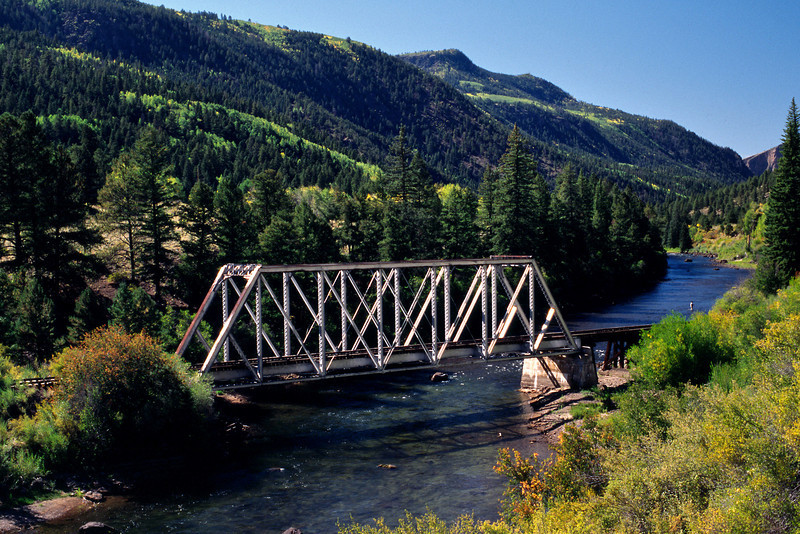 Steel railroad bridge over the Rio Grande River, Hwy 149, Colorado.