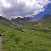Beth along the trail amid wildflowers in American Basin, CO.<br /> July 21, 2013