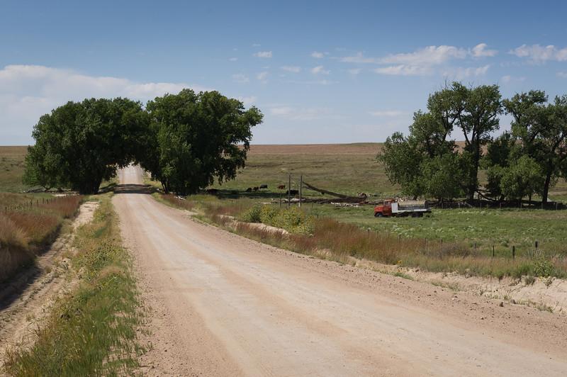 Gravel road with truck. Kansas.