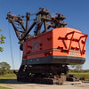 Big Brutus is the largest electric shovel in the world -<br /> 16 stories tall (160 feet). <br /> It  weighs 11 million pounds. The dipper capacity is 90 cu. yds (by heaping,  or 150 tons - enough to fill three railroad cars.) West Minerral, Kansas.