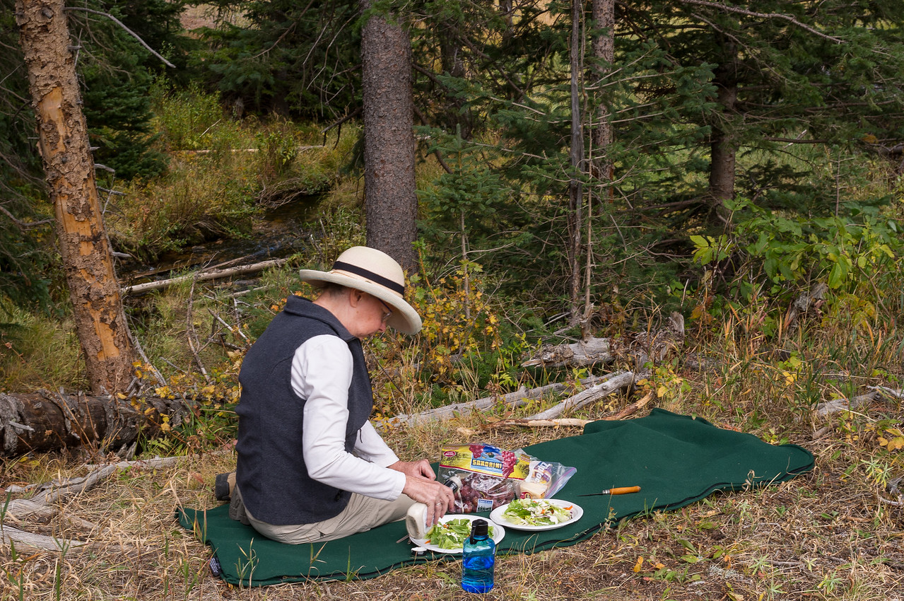 Rita dressing the salads for a picnic. Rocky Mountain National Park, Colorado.