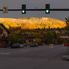 A shaft of sunlight spotlights an aspen covered mountain behind Steamboat Springs, Colorado.