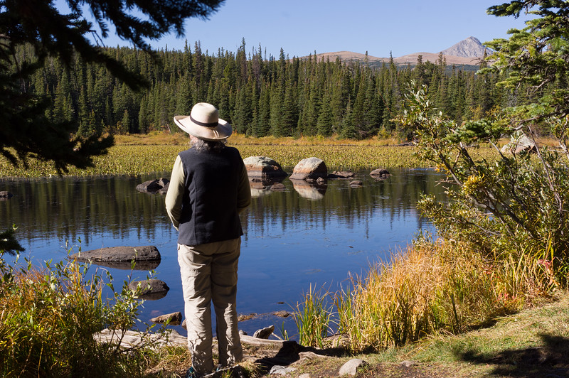 Rita admiring the view at a small Lake in the Brainard Lake Recreation area, Colorado.