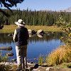 Rita admiring the view at a small Lake in the Brainard Lake Recreation area, Colorado.