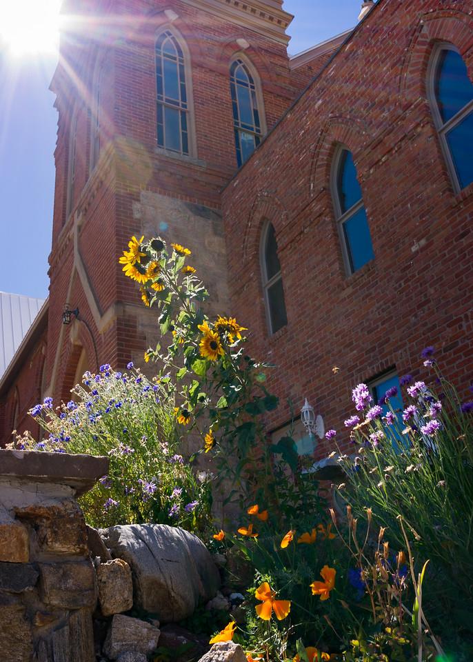 Flower garden and church, Central City, Colorado.