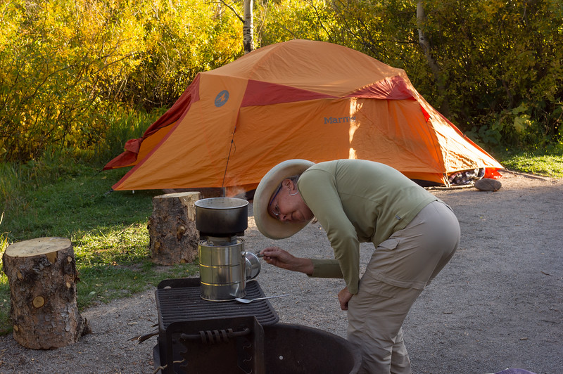 Rita feeding the stick stove, Camp Dick, Roosevelt National Forest, Colorado.