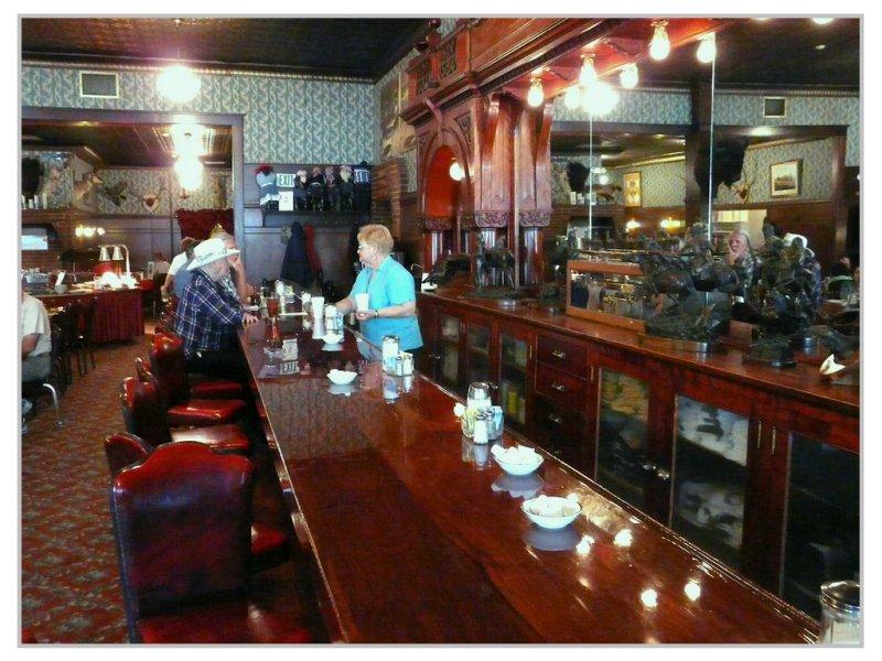Cherry wood bar at the Irma Hotel (101383173)