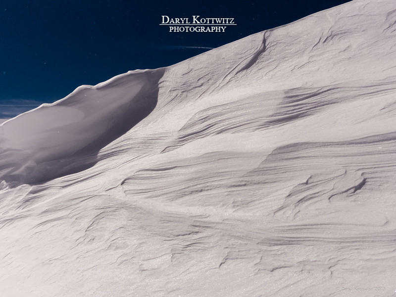 """Nature's Carving"" - This was shot at the top of the main ski lift at Arapahoe Basin.  The star-like specs you see in the sky was snow blowing over the top of the drift...it was windy up there!"