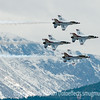 USAF F-16 Thunderbird jets fly across the Front Range during the USAF Academy Graduation flyover ceremony.