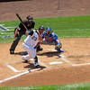 Colorado Rockies' 1st baseman Jason Giambi swings and misses against the Cubs.