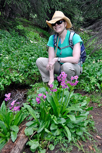 Marsha with fairy primroses she discovered. We've hiked in Colorado summers for 17 years and have only seen fairly primrose 4 or 5 times.