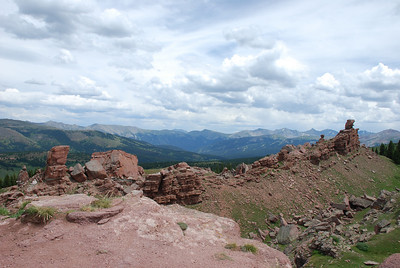 Looking over the formations on Shrine Ridge towards where the Gore Range on the left  and the Ten Mile Range come together at Copper, the ubiquitous afternoon clouds begin to form.