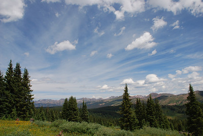 Shrine Ridge. Monday, August 3. Shrine Ridge near Vail Pass looking back at the Gore Range.  Remakable mountain sky seems to come at you from all directions.