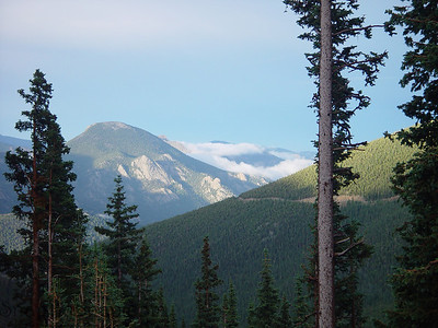 A mountain summit, clouds, and a valley in Rocky Mountain National Park.